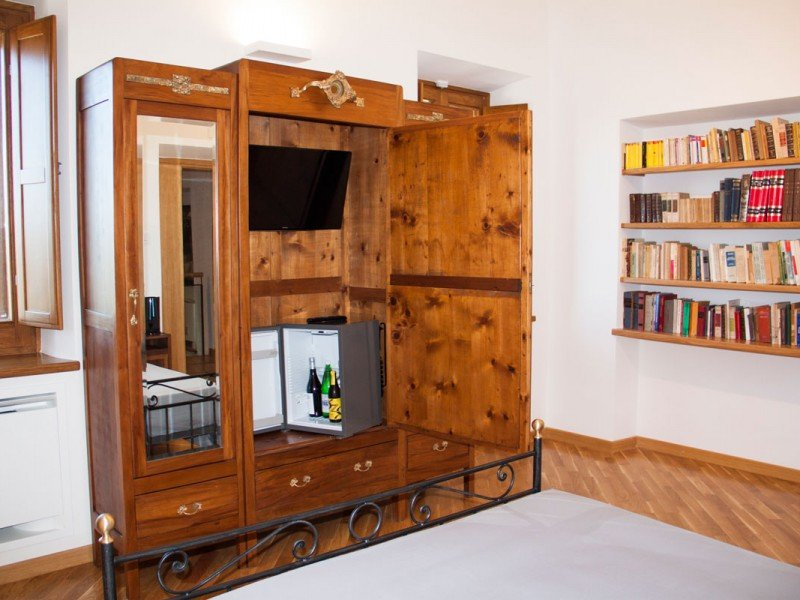 Fresh drinks always available in your bedroom's minibar - Comfort stay in Italy