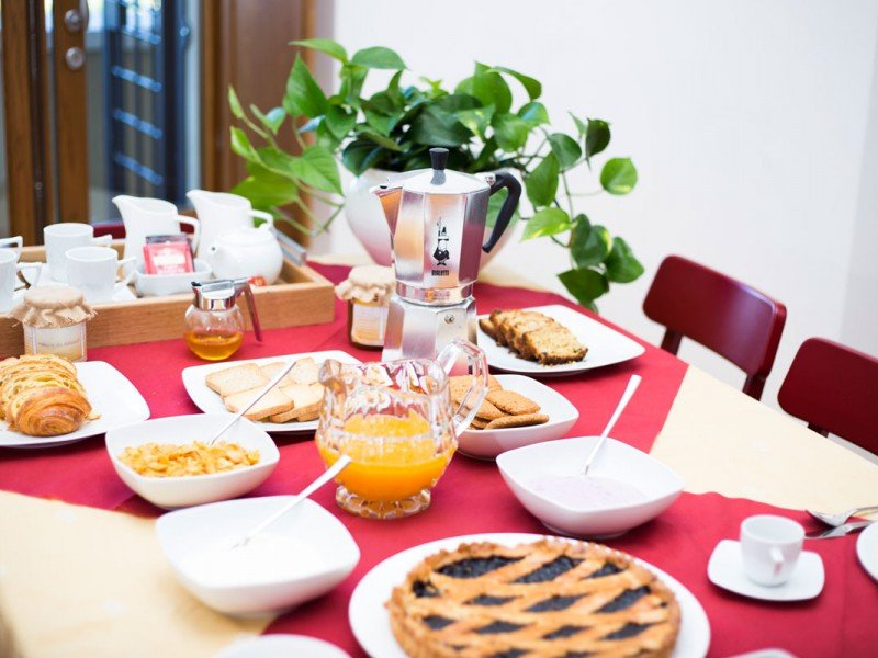 Delicious Italian daily breakfast with espresso coffee and crostata - Cooking stay in Italy