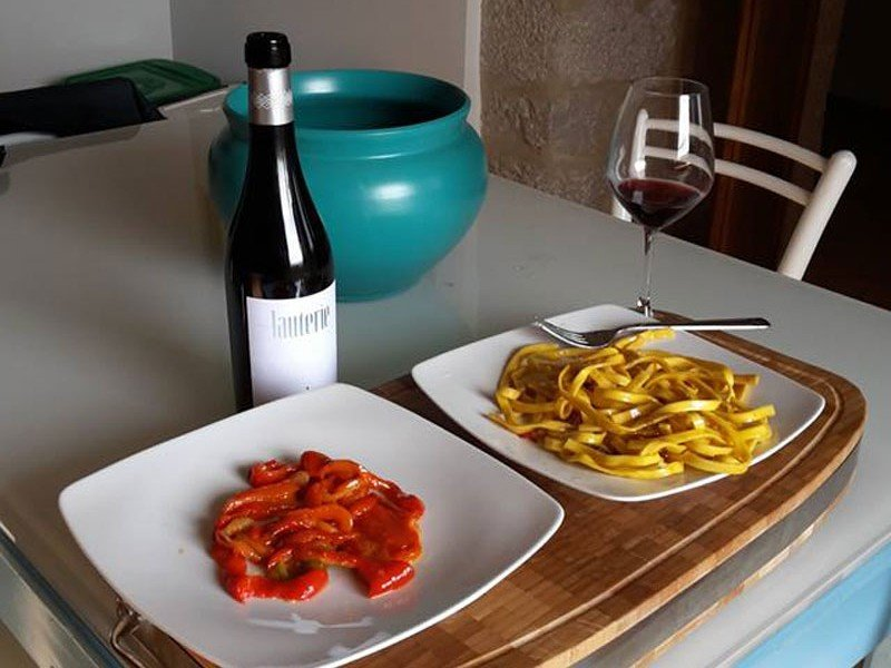 Tasty Italian food and a glass of red wine - Italy Culinary Holiday