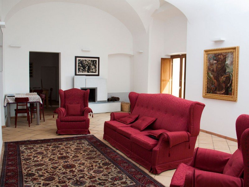 Sip a glass of wine in the relaxing atmosphere of the main lounge - Historical building stay in Italy
